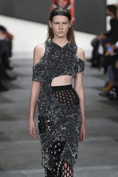 Knit dresses were slashed and swirled around the body revealing layers of sequins and fishnet at@proenzaschouler#NYFW #AW15