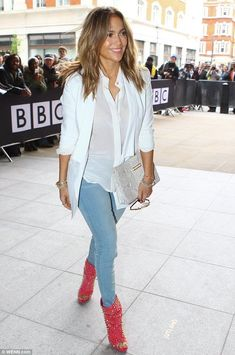 Conservative: Jennifer wore a sheer white shirt, jacket and skinny blue jeans with the red boots