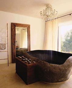 sculpted Balinese granite bathtub