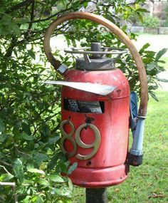 An old fire extinguisher made into a mailbox, such a great idea for a fireman.