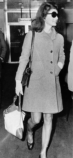 Frida's two bag muse: The singular Jackie Kennedy, snapped leaving Heathrow in '68 with two Gucci bags. Photo