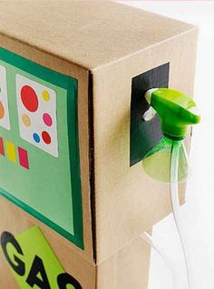 A gas pump. | 31 Things You Can Make With A Cardboard Box That Will Blow Your Kids' Minds