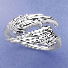 Angel Wings Ring at pyramidcollection.com Feeling virtuous? Try one of these on your, uh, wing finger. Gracefully furled and heavenly detailed, seraphic feathers grace the front of this spirit-lifting sterling silver ring. Whole sizes 5 - 10. **** Angel Wings Ring Item #: P11381 Price: $29.95