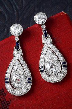 A pair of Art Deco platinum, diamond and sapphire earrings. #ArtDeco #platinumdiamond #Earrings