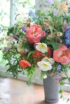 lush organic colorful pink, white, yellow, blue and purple flower arrangement | floral design: Floret Flowers