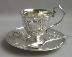 Antique British silver tea cup, saucer and spoon.