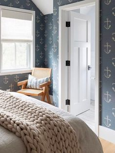 If you keep it neutral, and especially gray, the nautical theme takes on a modern sleek look. Featured on Completely Coastal along with other wallpaper ideas for any room in the home!