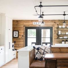 WEBSTA @ magnolia - We love this kitchen from last week's reveal! The white cabinets, stained shiplap, black iron details, and built-in booth made this kitchen one of the most unique we've seen! Get ready for an all new Fixer Upper tonight at CT on HGTV. House, Shiplap, Home, Shiplap Kitchen, Ship Lap Walls, Kitchen Remodel, Kitchen Decor, Fixer Upper, Home Kitchens