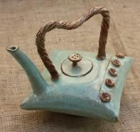 Pillow Teapot by Zenceramics This teapot is hand-built using Japanese origami folding technique, has multiple glazes applications and high fired.