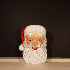 Hey, I found this really awesome Etsy listing at https://www.etsy.com/listing/536489470/vintage-irice-santa-head-candleholder