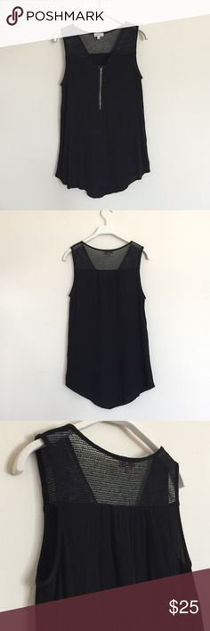 Pixley Black tank with mesh and zipper front small Cute tank with zipper front detail. Mesh at the shoulders and upper back. 100% rayon. Bundle to save 25%! Pixley Tops Tank Tops