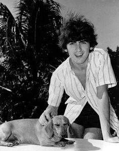 George Harrison poses with a dachshund named Bendix at his home in the Bahamas    in 1964.