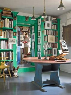 art and books--natural partners in this in-house green cottage Library