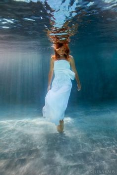 Got an urge to do an underwater styled shoot.  Got the pool. Looking for a keen model???