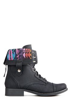 Show off your inner beauty with Tamia by JustFab, a lace-up bootie with a fold-over design and cool tribal print fabric inset.