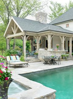 Covered patio - great outdoor living space; love the traditional look with light tones, shades of white with turquoise.
