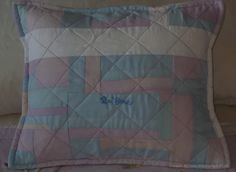 Cushion made with remainder of fabric from quilt.  Front