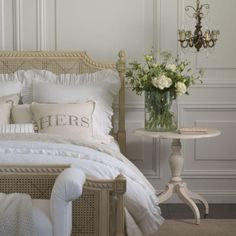 Vintage white, beige, and cream bedroom!  So beautiful!!!! I want to run up to that bed and jump right on top!! Lol