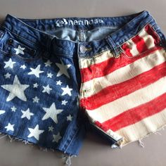 DIY American Flag shorts! Turned out just like I planned :) painted on stars and bleach with fabric marker for the stripes!