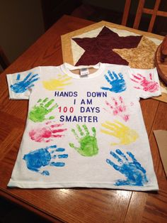Jacobs 100th day of school shirt. 11 hand prints on front and 9 on the back. Total of 100 fingers.
