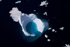 Iceberg off Sydproven, Kitaa, Greenland by Yann Arthus Bertrand