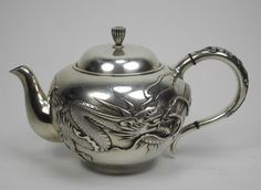 Japanese silver teapot with dragon design around the body (Photo: courtesy of Live Auctioneers)