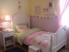 This is a girl's room with a pink, purple