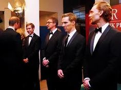 """Tom Hiddleston and Benedict Cumberbatch wait their turn to greet the Prince in a receiving line at the UK premiere of the movie, """"War Horse.""""  From rebloggy.com."""