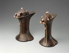 Leather chopines (platform shoes), Italian (Venice), 1590-1610. Brown leather split vamp stamped in chevron motif, trimmed with pink silk tassels. Open toe and sides; wood or cork stilt covered with brown leather with gilt-copper tape over front and back seams. Leather sole, insole, lining. MFA Boston.