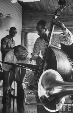 Bassist Percy Heath demonstrates a technique to a student at the summer jazz workshop in Lenox, Mass. in 1959. By Alfred Eisenstaedt