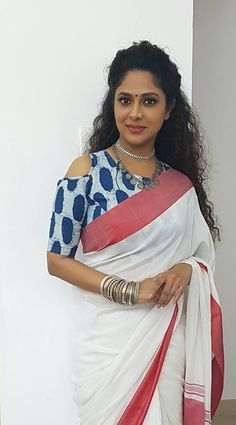 Poornima indrajith in white saree with navy blue blouse. #pranaah