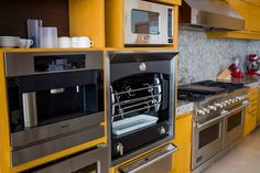 High-end appliances round out this top-of-the-line kitchen #CousinsOnCall