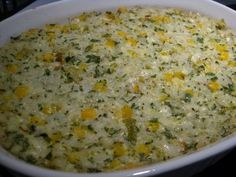 Mexican Sour Cream Rice-this is awesome!  We loved it and it wasn't too spicy for the kids.  Great Mexican side dish!  1 cup uncooked long grain white rice  1 (14 ounce) can chicken broth  1 cup sour cream  1 (4 ounce) can diced green chile peppers  2 cups shredded pepper Jack cheese, divided  1 1/2 cups frozen corn  1/4 cup finely chopped fresh cilantro  salt and ground black pepper to taste