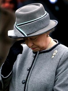 Queen Elizabeth II wipes a tear as she observes a two minute silence at the Sandringham War Memorial in Norfolk to mark the 90th Anniversary of the Gallipoli campaign, 2005.