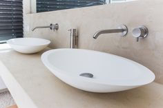 Get inspired... byCOCOON.com for Contemporary Minimalist Modern Luxury Design Bathrooms. This elegant Corian washbasin PORROIG by #COCOON on shelf and Mono set2 wall-mounted basin mixer by #COCOON are available via byCOCOON.com. #COCOON #Inox #StainlessSteel taps are also available via inoxtaps.com / Hotel bathroom design project by COCOON.