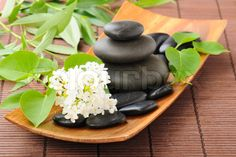 Image of 'zen stones and flowers on the mat'