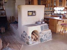 Rocket (Stove) Mass Heater: centrally located, couch & cooktop