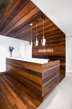 Heat-treated wooden ceiling and desk. Private bank in Montreal @ Lombard Odier Office Reception Design, Reception Areas, Reception Desks, Wooden Ceiling Design, Wooden Ceilings, Private Bank, Wooden Cabins, Heat Treating, Cabin Interiors