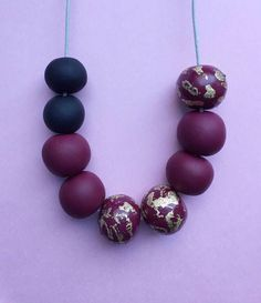 Burgundy clay necklace, polymer clay beads, gold foil