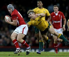 Australia's David Pocock stretches out to tackle Wales' Jonathan Davies