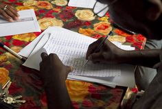 July 2012, Haiti -- UNDP works with the UN Mission in Haiti to help the Government there prepare for its next disaster. A member of the Haitian Department of Civil Protection registers evacuated residents at a school which serves as a shelter during a disaster response simulation on 9 July. www.undp.org