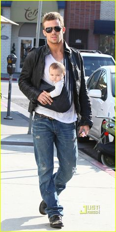 Cam Gigandet - possible Christian Grey. He's carrying a kid in this pic and looks hot doing it. I'd consider him when casting!