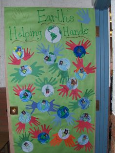 Earth's Helping Hands classroom door decoration for Earth Day. Each student lists five things (one on each finger) that he/she will do to help Earth.