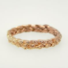 Rose gold wedding band...braided metal is unique!