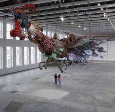 Phoenixes made from recycled materials from construction sites by Xu Bing