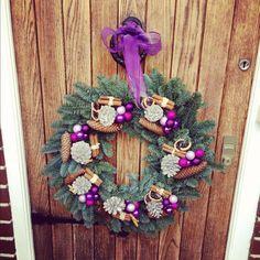 Christmas wreath with cones, orange slices, baubles & cinnamon