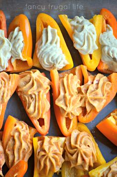 Mini sweet bell peppers with hummus piped on with a pastry bag.  Could make these look like candy corn?