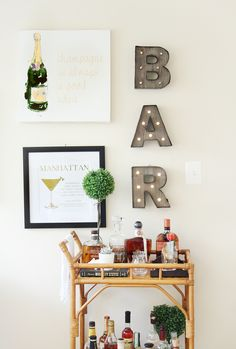 Want to add a bar cart to your home but don't know where to start? You've come to the right place! Bar carts are a huge trend that we are certainly on board with, but it can be hard to find out exactly what to add to your bar cart or how to even start… Home Bar Decor, Bar Cart Decor, Target Home Decor, Ikea Bar Cart, Diy Bar Cart, Kitchen Bar Decor, Home Bar Signs, Pub Decor, Home Decor Ideas