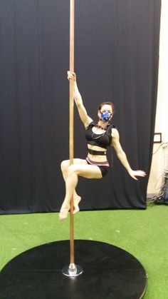 Pole dancer in Fireman position, fitted with K5 wearable metabolic equipment for the measurement of oxygen consumption and other parameters.