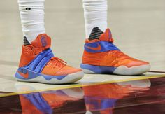 LeBron James and Kyrie Irving wear alternate sneaker colorways to match throwback uniforms.